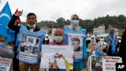 Members of Uyghur community living in Turkey stage a protest outside the Chinese consulate in Istanbul, June 2, 2021. They protest agains alleged oppression by the Chinese government to Muslim Uyghurs in far-western Xinjiang province.