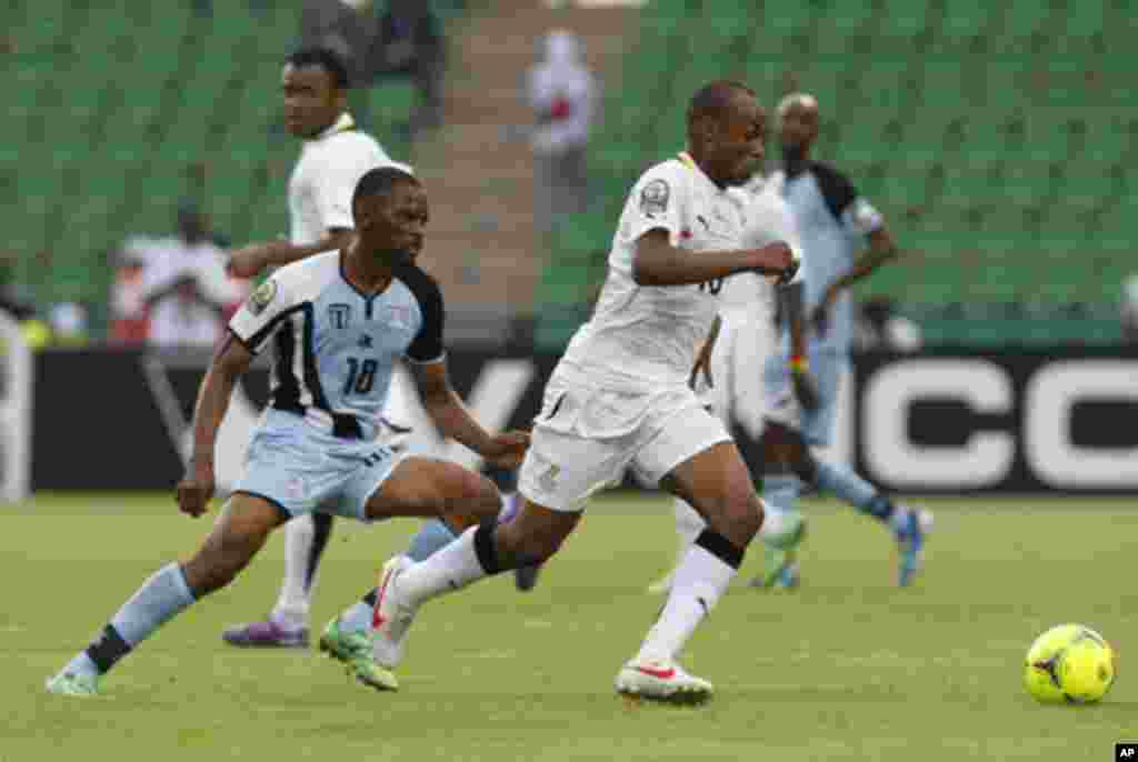 Ghana's Andre Ayew (R) challenges Mogogi Gabonamong of Botswana during their African Cup of Nations Group D soccer match in FranceVille Stadium January 24, 2012.