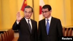中国国务委员兼外交部长王毅和日本外相河野太郎2018年4月15日在日本东京举行会谈。