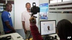 A Haitian has his photo taken at the Interior Ministry as he registers for legal residency in Santo Domingo, Dominican Republic, June 16, 2015.