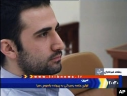 FILE - In this video frame grab image made from the Iranian broadcaster IRIB TV, U.S. citizen Amir Mirzaei Hekmati, accused by Iran of spying for the CIA, sits in Tehran's revolutionary court, in Iran, Dec. 27, 2011.