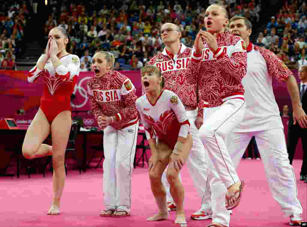 Russian gymnasts and team officials react to teammate Kseniia Afanaseva's fall while performing on the floor during the Artistic Gymnastics women's team final.