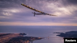 "FILE - ""Solar Impulse 2,"" a solar-powered plane piloted by Bertrand Piccard of Switzerland, flies over the Golden Gate bridge in San Francisco, California, U.S. April 23, 2016, before landing on Moffett Airfield following a 62-hour flight from Hawaii."