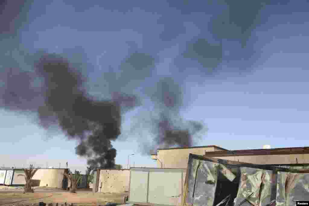 Clashes between rival militias have wrecked havoc for the last several weeks causing concerns that Libya is sliding deeper into turmoil, in Tripoli, Aug. 24, 2014.