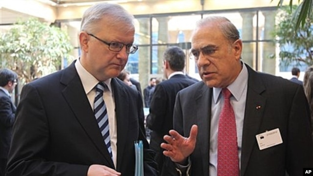 OECD chief Angel Gurria, right, with European Commissioner for Economic and Monetary Affairs Olli Rehn, Brussels, March 27, 2012.