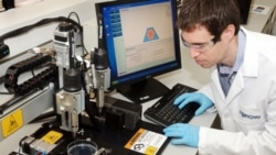 Scott Dorfman, an engineer at Organovo, working on the NovoGen bio-printer