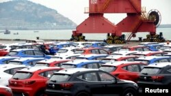 Sports utility vehicles (SUVs) waiting to be exported are seen at a port in Lianyungang, Jiangsu province, China, April 5, 2018.