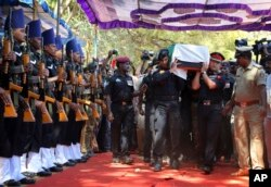 The body of India's National Security Guard commando, Niranjan Kumar, is carried by Indian soldiers as they pay their last respects in Bangalore, Jan. 4, 2016.