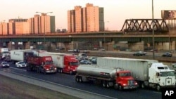 A file photo of traffic near Chicago, Illinois. Economists say trucks carry nearly 70 percent of American freight.