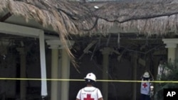 Mexican Red Cross rescuers check a damaged area of the Grand Riviera Princess Hotel in Playa del Carmen, Quintana Roo state, Mexico, Sunday Nov. 14, 2010.