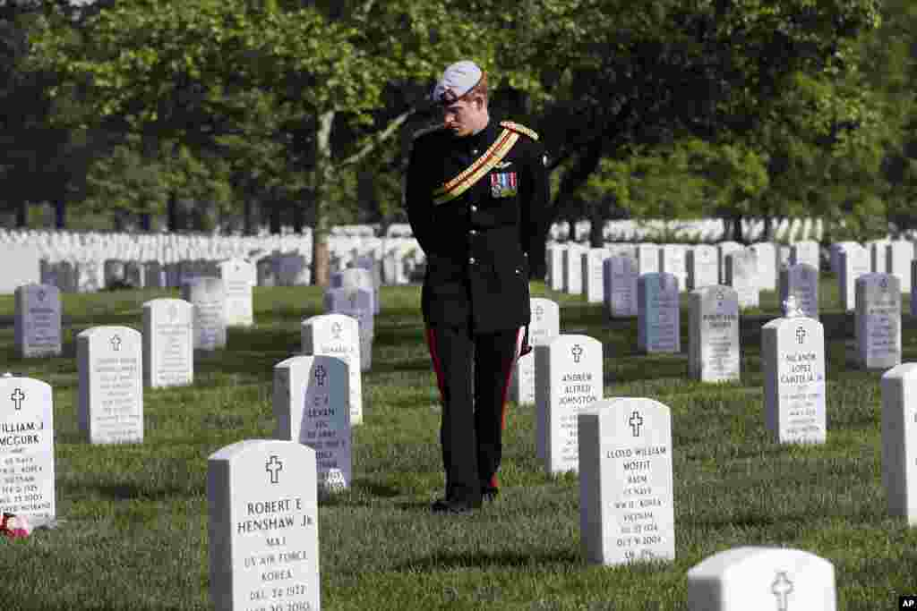 England's Prince Harry visits Section 60 at Arlington National Cemetery, near Washington D.C.  The British soldier-prince is spending most of his week in the U.S. honoring the wounded and the dead of war.