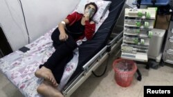 A civilian breathes through an oxygen mask at al-Quds hospital after an alleged chlorine gas attack alongside barrel bombs on a neighborhood of Aleppo, Syria, Aug. 11, 2016.