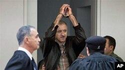 A May 27, 2010 file photo of Israeli Arab activist Amir Makhoul (C) arriving at Haifa's district court