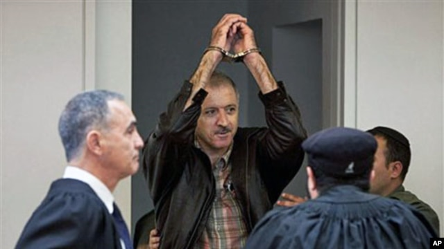 A May 27, 2010 file photo of Israeli Arab activist Amir Makhoul (C) arriving at Haifa's district court