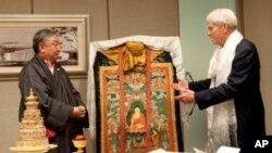 Special Envoy Kasur Lodi Gyari (L) presents His Holiness the Dalai Lama's gifts to Dr James Billington, Librarian of the Library of US Congress