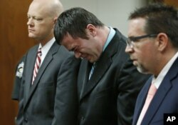 Daniel Holtzclaw, center, cries as he stands in front of the judge after the verdicts were read in his trial in Oklahoma City, Dec. 10, 2015.