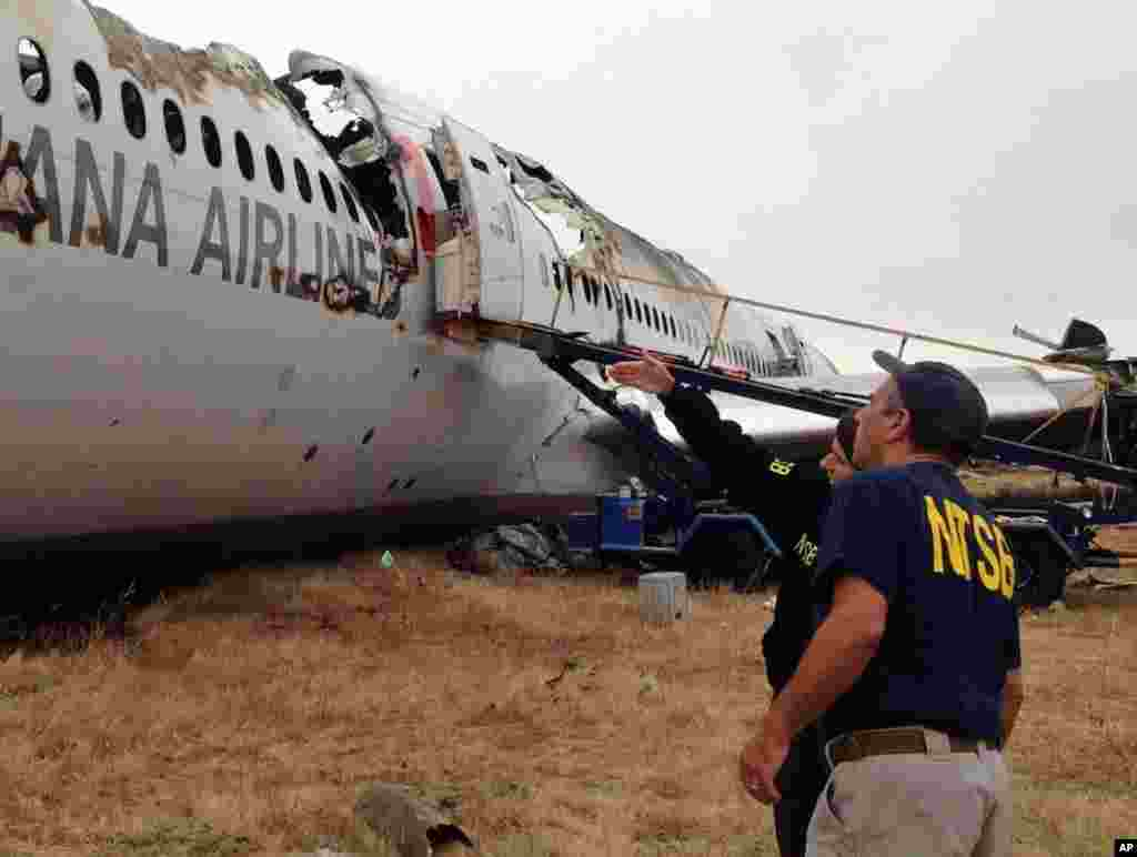 This NTSB photo shows Investigator in Charge Bill English and Chairperson Deborah Hersman discussing the progress of the investigation into the crash of Asiana Airlines Flight 214 in San Francisco, July 9, 2013.