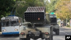 "Pro-Russian rebels drive Grad multiple rocket launchers in the town of Donetsk, Ukraine, Sept. 11, 2014. The European Union on Tuesday condemned recent clashes in eastern Ukraine between pro-Russian rebels and government forces, calling the fighting a ""blatant violation"" of the Minsk truce."