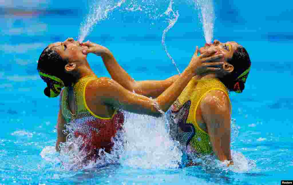 Mexico's Isabel Delgado Plancarte and Nuria Diosdado Garcia perform in the synchronized swimming duets free routine qualification round.