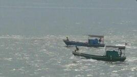 Boats sail on the South China Sea.