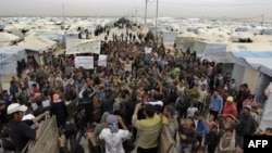Syrian refugees take part in a demonstration at the Zaatari refugee camp, near the border with Syria.