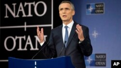 FILE - NATO Secretary General Jens Stoltenberg speaks during a media conference after a meeting of NATO defense ministers at NATO headquarters in Brussels.