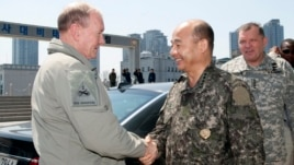 South Korean Joint Chiefs of Staff Chairman Gen. Jung Seung-jo (C) shakes hands with his US counterpart, Gen. Martin Dempsey as US Gen. James D. Thurman, the commander of US forces in South Korea looks on in Seoul April 21, 2013.