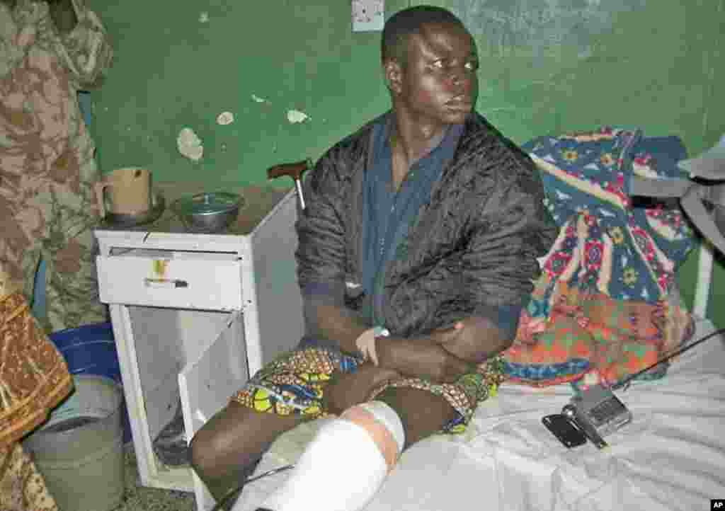 A survivor of a bomb blast at a church rests on a hospital bed in Nigeria's central city of Jos February 26, 2012.