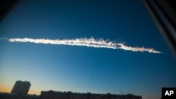 A meteorite contrail is seen over Chelyabinsk, February 15, 2013.