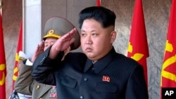 FILE - In this image taken from video, North Korean leader Kim Jong Un salutes during the ceremony to mark the 70th anniversary of the country's ruling party in Pyongyang, Oct. 10, 2015.