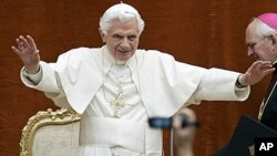 Pope Benedict XVI greets the faithful during the weekly general audience at his summer residence of Castel Gandolfo, in the outskirts of Rome. Benedict XVI lands Thursday in the Spanish capital of Madrid for a four-day visit to greet up to a million or mo