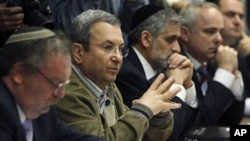 Israel's Defence Minister Ehud Barak (2nd L) attends the weekly cabinet meeting in Jerusalem April 10, 2011