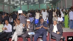 Somalis react in favour of Somalia's new draft constitution, in Mogadishu, Somalia,Wednesday, Aug. 1, 2012. Somali leaders voted overwhelmingly on Wednesday to adopt a new constitution that contains new individual rights and sets the country on a course f