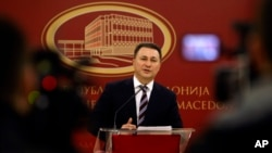 Macedonian Prime Minister Nikola Gruevski announces his resignation in front of the media in Skopje, Jan. 14, 2016.
