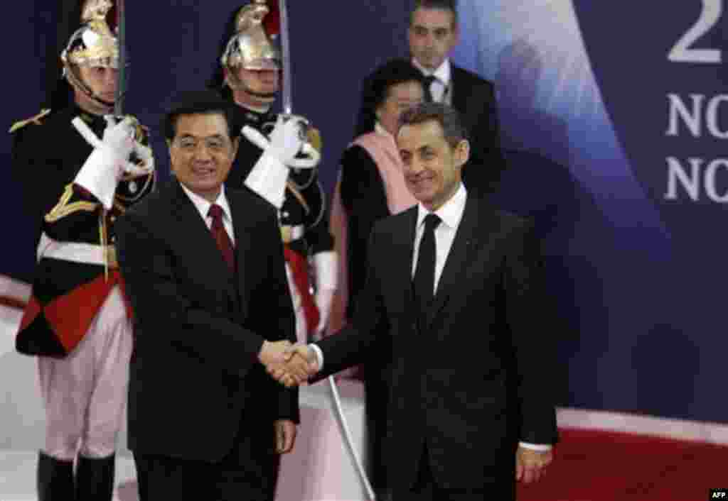 French President Nicolas Sarkozy, right, shakes hands with China's President Hu Jintao during arrivals for the G20 summit in Cannes, France on Wednesday, Nov. 2, 2011. Greek Prime Minister George Papandreou was flying to the chic French Riviera resort of