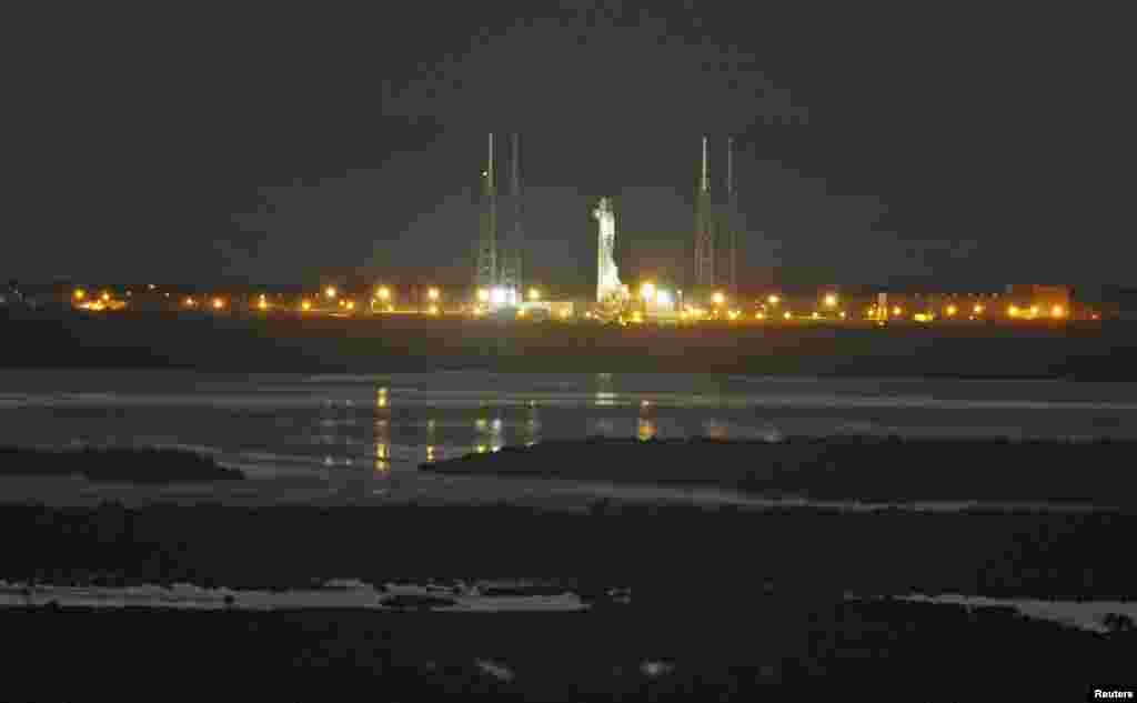 The unmanned Falcon 9 rocket being launched by SpaceX on a cargo resupply service mission to the International Space Station sits on the launch pad after an aborted liftoff from the Cape Canaveral Air Force Station in Cape Canaveral, Florida, Jan. 6, 2015.