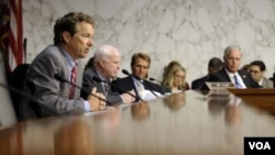 Senate Foreign Relations Committee members, from left, Sen. Rand Paul, Sen. John McCain, Sen. Jeff Flake, and Sen. Ron Johnson listen on Capitol Hill, Sept. 4, 2013, during the committee's hearing to consider the authorization for use of military force in