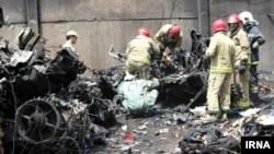 Hiện trường tai nạn gần phi trường Mehrabab ở Tehran, ngày 10/8/2014.