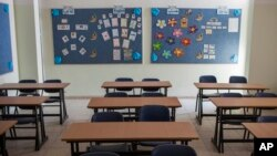 FILE - An empty classroom is seen at a school in the central Israeli city of Ramle, Sept. 22, 2015.