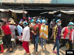 FILE: Garment workers take lunch break at Propitious (Cambodia) Garment Ltd, in Kandal Province, March 20, 2020. (Kann Vicheika/VOA Khmer)