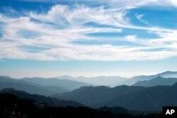 "FILE - The Himalayan mountain range is seen on ""International Mountain Day"" from Shimla, India, Dec. 11, 2008."