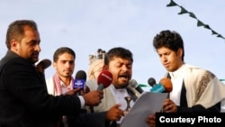 Radwan al-Haimi (R) holds a microphone as Mohammed Ali al-Houthi, President of the Houthi's Revolutionary Committee, speaks to the media, January 23, 2015. (Photo courtesy of Radwan al-Haimi, Sana'a, Yemen.)