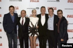 FILE - Actor Jason Isaacs, writer and director Armando Iannucci, actors Andrea Riseborough, Michael Palin, Paul Whitehouse and David Schneider at UK premiere of 'The Death of Stalin', in London, Oct. 17, 2017.