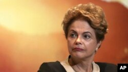 "FILE - Brazil's President Dilma Rousseff attends an event launching the ""Olympic Year for Tourism"" in Brasilia, Brazil, Oct. 7, 2015."