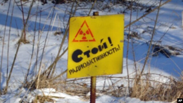 "A sign on the perimeter of the 30-kilometer evacuation zone around the Chernobyl nuclear plant reads ""Stop! Radioactive Zone."" (VOA - Taras Burnos)"