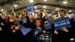 Supporters cheer as Democratic presidential candidate, Sen. Bernie Sanders, I-Vt., arrives during a rally on March 11, 2016 in Summit, Ill.