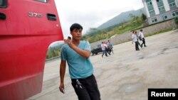 FILE - A Chinese truck driver arrives at customs at the border between China and North Korea near Hunchun, Jilin province, Aug. 29, 2011.