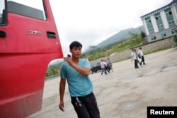 FILE - A Chinese truck driver arrives at customs at the border between China and North Korea near Hunchun, Jilin province. There have been reports of expanded economic development at the China, North Korea border.