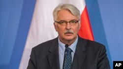 FILE - Polish Foreign Minister Witold Waszczykowski speaks during a press conference in Budapest, Hungary, in February 2016.