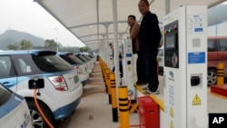 New electric-powered taxis are charged at a public charging station in Shenzhen city, south China's Guangdong province, Jan. 7, 2019.